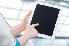 Blank computer tablet in the hands of doctor Royalty Free Stock Photography