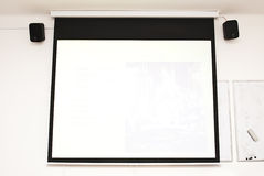Blank conference room projector screen and audio Royalty Free Stock Photo