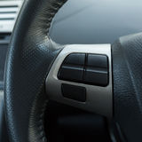 Blank control button on car steering wheel used Royalty Free Stock Photo