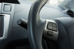 Blank control button on car steering wheel used Stock Image