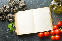Blank cookbook and ingredients Royalty Free Stock Photos