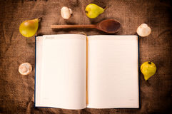 Blank cookbook. Cookbook with mushrooms and pear from above Royalty Free Stock Photography