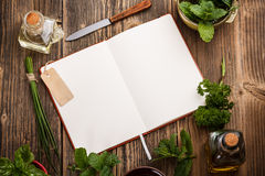 Blank cookbook. For recipes with herbs Stock Photography