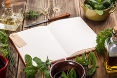 Blank cookbook. For recipes on old wooden background Stock Photography