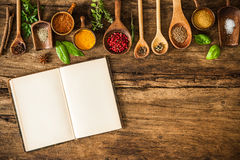 Blank cookbook and spices. On wooden table Stock Images