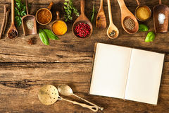 Blank cookbook and spices. On wooden table Royalty Free Stock Photos