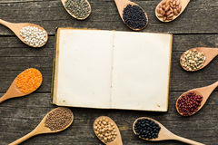 Blank cookbook and various legumes Stock Image