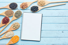 Blank cookbook and various legumes Royalty Free Stock Photo