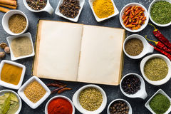 Blank cookbook and various spices. Royalty Free Stock Images