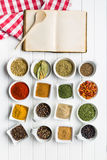 Blank cookbook and various spices. Stock Image