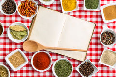 Blank cookbook and various spices. Blank cookbook and various spices and herbs. Top view Stock Image