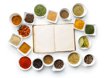 Blank cookbook and various spices. Royalty Free Stock Photo