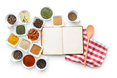 Blank cookbook and various spices. Royalty Free Stock Image