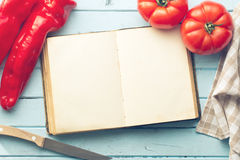 Blank cookbook and vegetable Royalty Free Stock Images