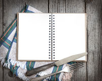 Blank cooking recipe book on wooden table Stock Images