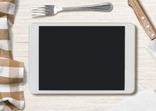 Blank cooking recipe notes on tablet pc. Cooking recipe notes on tablet pc lying on table Stock Images