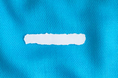 Blank copy space scrap of paper on blue background cloth of textile Stock Photography