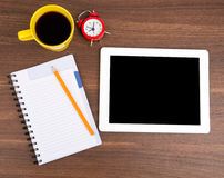 Blank copybook with tablet and alarm clock Royalty Free Stock Photo