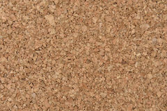 Blank cork board. Blank cork-board with some pins in the corner, white background Royalty Free Stock Photo
