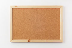 Blank cork board with wooden frame. A blank bulletin board Stock Images