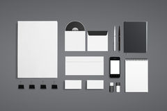 Blank Corporate ID Set. Isolated on grey. Consist of Business cards, envelopes, a4 letterheads, notebooks, flash, pencile, cd disk and smart phone Stock Images