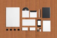 Blank Corporate ID Set. On wooden background. Consist of Business cards, envelopes, a4 letterheads, notebooks, flash, pencile, cd disk and smart phone Stock Photos