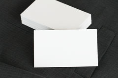 Blank corporate identity package business card with dark grey suit background. royalty free stock images