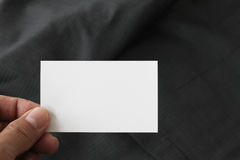 Blank corporate identity package business card with dark grey suit background. stock photography