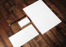 Blank corporate identity set. Photo of blank stationery and corporate identity set on vintage wooden table background: letterhead, business cards, envelope and Royalty Free Stock Image