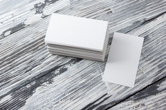 Blank corporate identity template package business cards on wood table. Stock Images