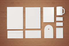 Blank Corporate identity templates. Corporate identity templates:blank, business cards, disk, envelope, cup, brand-book, note.  with soft shadows on wooden Stock Image