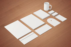 Blank Corporate identity templates. Corporate identity templates:blank, business cards, disk, envelope, cup, brand-book, note.  with soft shadows on wooden Royalty Free Stock Image
