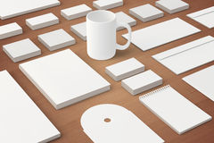 Blank Corporate identity templates. Corporate identity templates:blank, business cards, disk, envelope, cup, brand-book, note with soft shadows on wooden Royalty Free Stock Photos