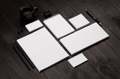 Blank corporate stationery on black stylish wood background. Branding mock up for branding, graphic designers presentations and business portfolios Stock Images