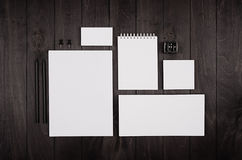 Blank corporate stationery on black stylish wood background. Branding mock up for branding, graphic designers presentations and bu. Siness portfolios Stock Photos