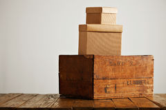 Blank corrugated cardboard boxes with vintage wooden box Stock Photos