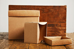 Blank corrugated cardboard boxes with vintage wooden box Royalty Free Stock Image