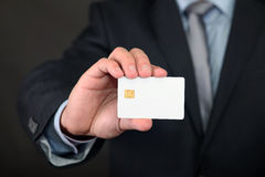 Blank credit card in hand Stock Photos