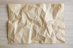 Blank crumpled paper on wooden background Stock Images