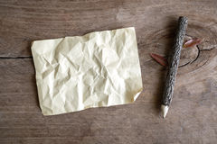 Blank crumpled paper and wooden pencil on wooden background Stock Photography