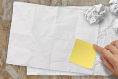 Blank crumpled sticky note paper on texture paper Stock Photo