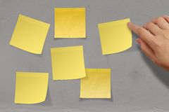 Blank crumpled sticky note paper on texture wall Stock Images