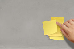 Blank crumpled sticky note paper on texture wall Royalty Free Stock Photo