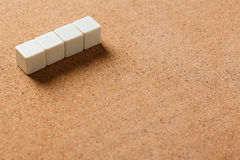 Blank cubes on cork board Stock Images