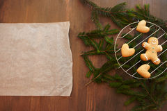 Blank culinary parchment with gingerbread cookies Royalty Free Stock Photography