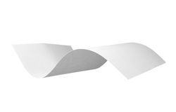 Blank curl paper flying in wind Royalty Free Stock Photography