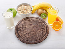 Blank cutting board with ingredients for cooking healthy food Royalty Free Stock Images