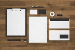 Blank 3d illustration stationery with black and white on wood Stock Image