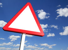 Blank danger ahead warning road sign. With sky on the background royalty free stock photos