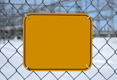 Blank danger sign. Blank high voltage danger sign with copy space at the chain link fence of a power station royalty free stock image